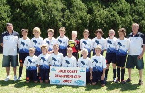 Led by current junior coach Paul Bebbington (left) Modbury Under 12s team contested the Gold Coast Champions Cup in 2007 with current A-League players Brandon Borrello (4th left), Jacob Melling (7th left) and longstanding Modbury players Chris Fleming (front left) and Mitch Coull (front right).